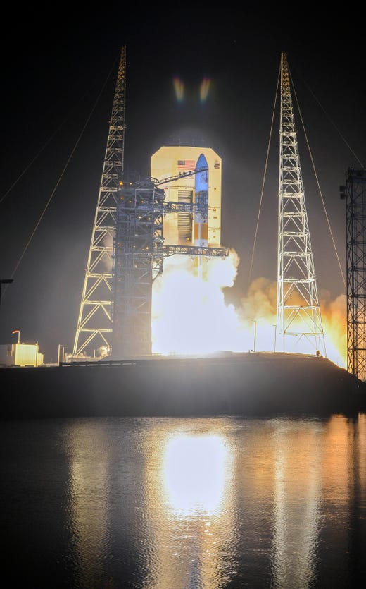 "A United Launch Alliance Delta IV Medium missile launches from the Cape Canaveral Air Force Station on Friday, March 15, 2019. The missile carries a communications satellite for the US military. ""data-id ="""